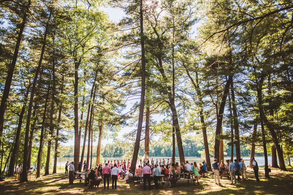 A lakeside ceremony taking place during a Long Lake Outdoor Center wedding