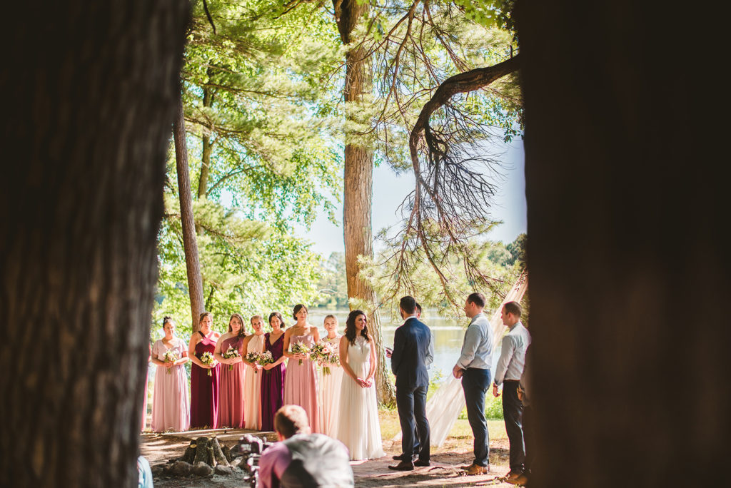 A ceremony in the woods during a Long Lake Outdoor Center wedding