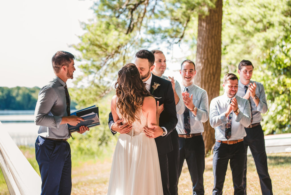 The Groom kisses the Bride during their wedding ceremony