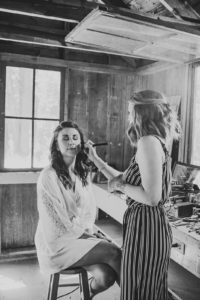 Bride getting her makeup done before her wedding day