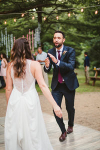 Bride and Groom share their first dance at their Long Lake Outdoor Center wedding