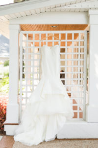 dress hanging before a Bay Pointe Inn wedding