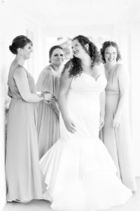 Bride and bridesmaids getting ready before a lakeside wedding in Shelbyville, Michigan