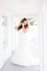 Bride getting dressed before her lakeside wedding