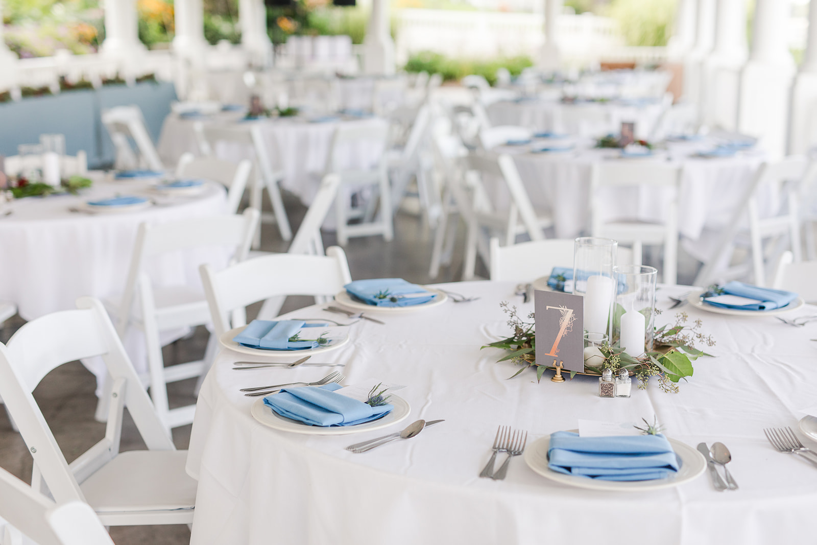 Tables set outside at a Bay Pointe Inn wedding in Shelbyville, Michigan