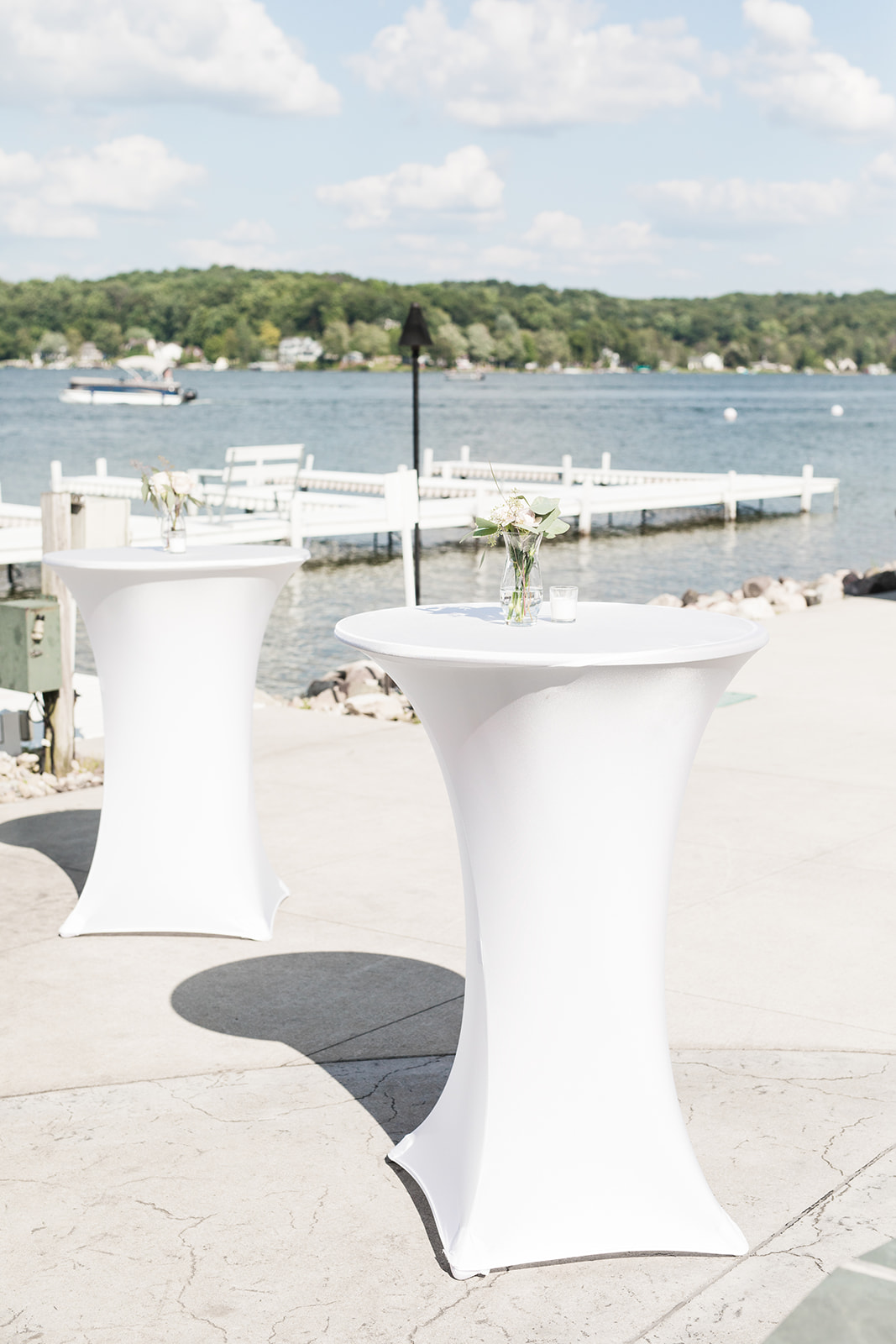 Cocktail tables set for a lake wedding venue in Michigan wedding