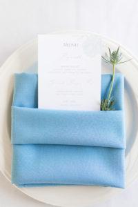 Dinner menus with blue napkins