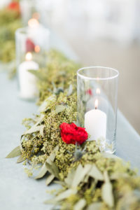Candles and a greenery garland
