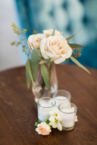 Bud vases on an end table at a wedding