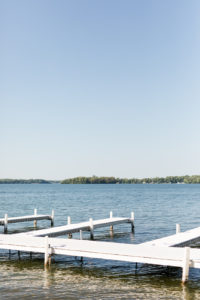 A summer day at the dock during a Bay Pointe Inn wedding in Shelbyville, Michigan