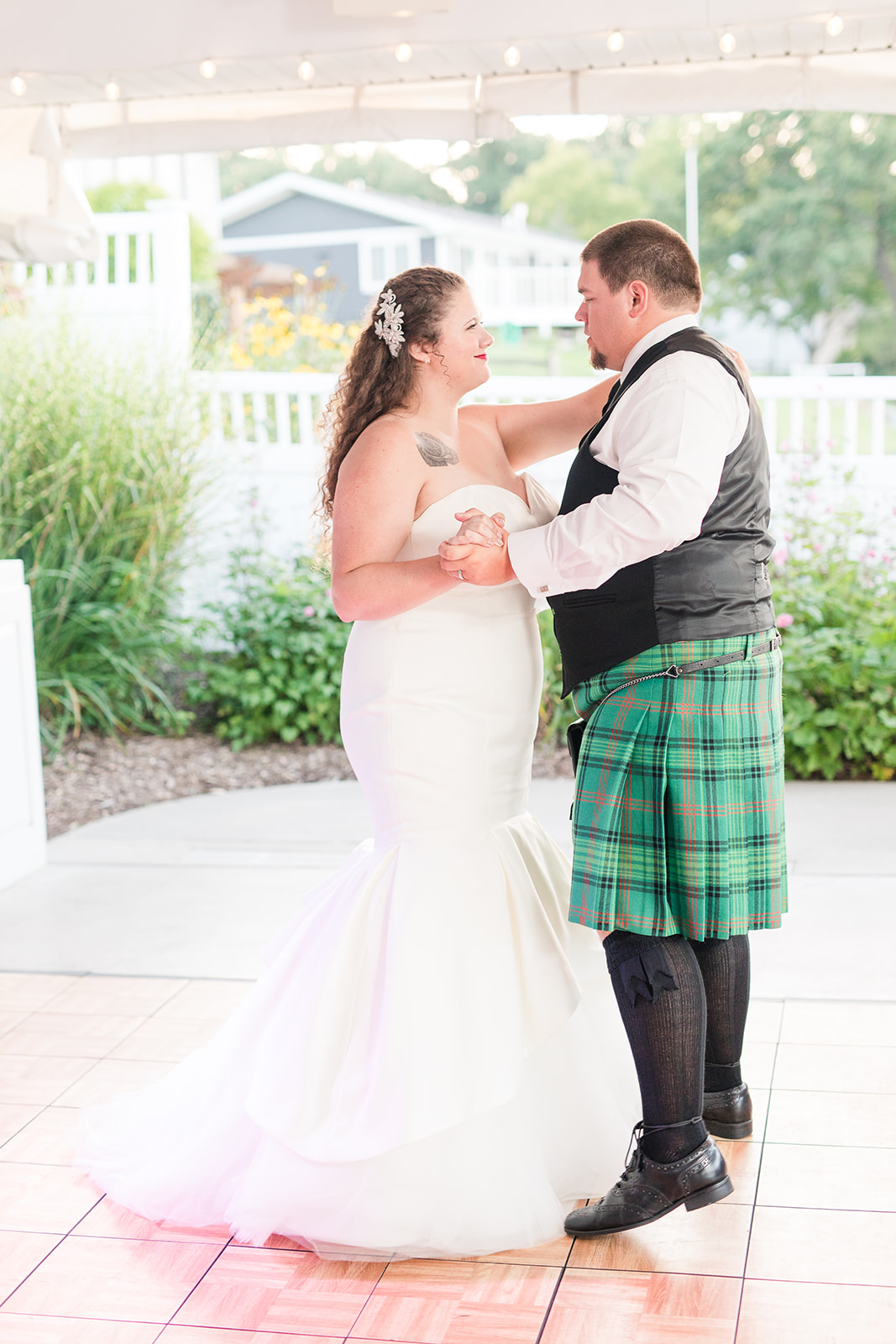 Bride and groom sharing their first dance at their Bay Pointe Inn wedding in Shelbyville, Michigan
