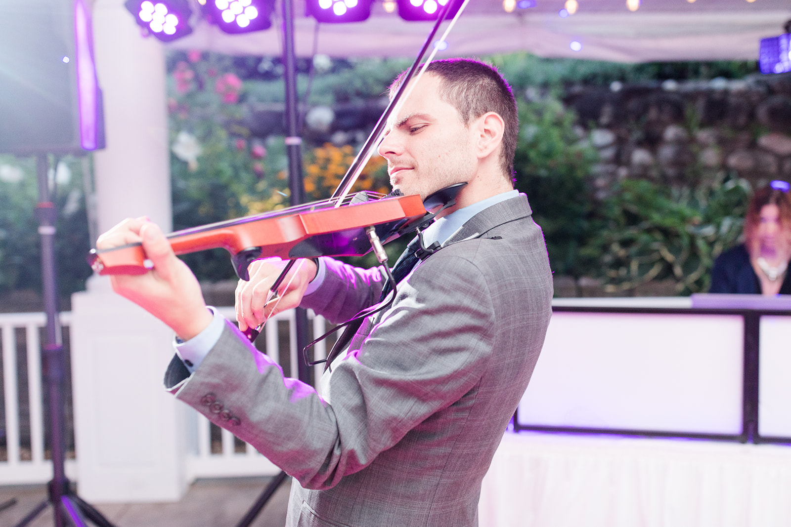 Violinist playing as guests dance