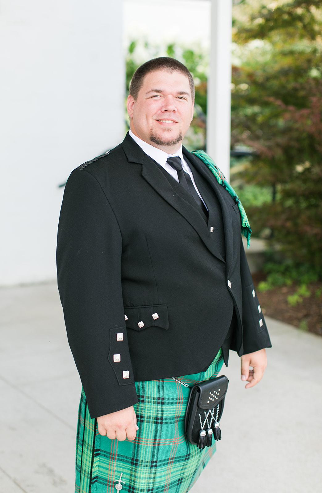 Groom dressed in traditional Scottish kilt