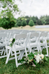 Ceremony chairs set on the felt estate before a wedding
