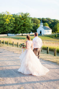 Bride and groom walking on the felt estate during sunset