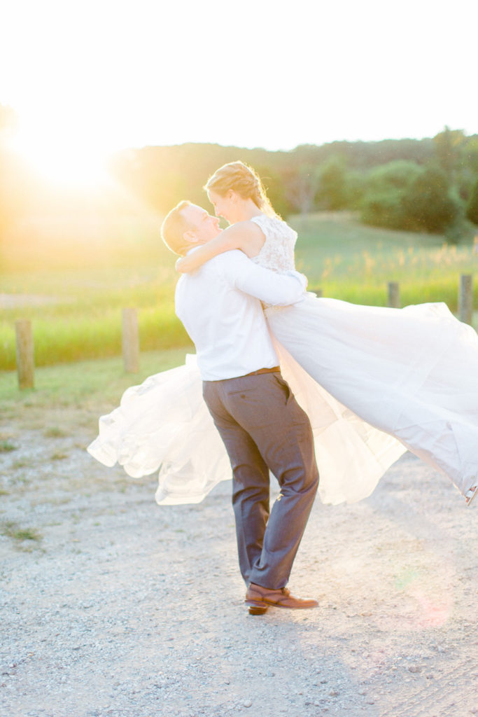 Bride and groom smiling during sunset at their felt mansion wedding