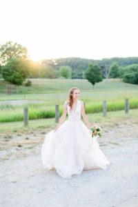 Bride smiling during sunset at her felt mansion wedding