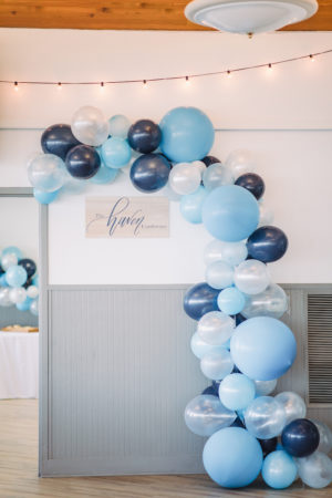 Blue balloon arch for The Haven Conference in West Olive, Michigan
