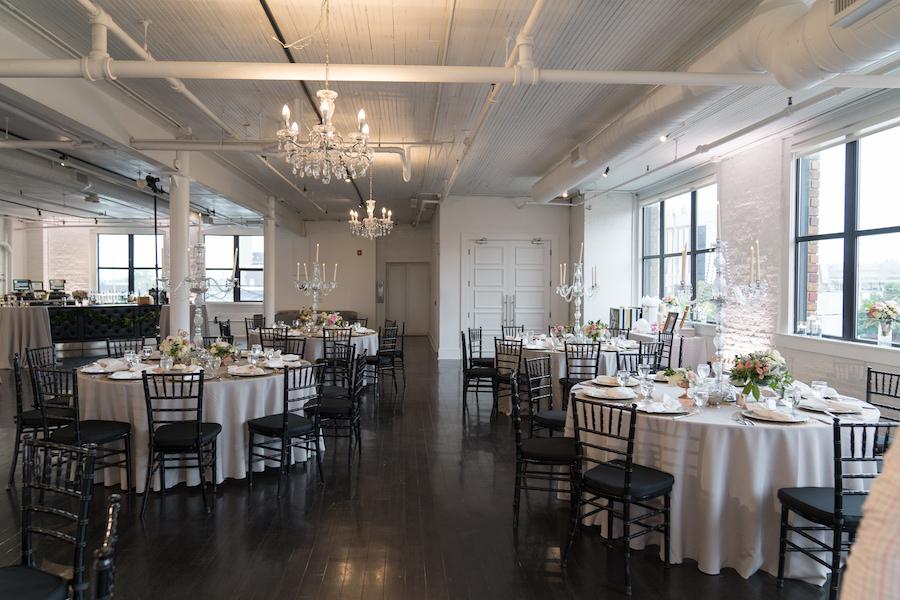 A reception space set for a Loft 310 wedding