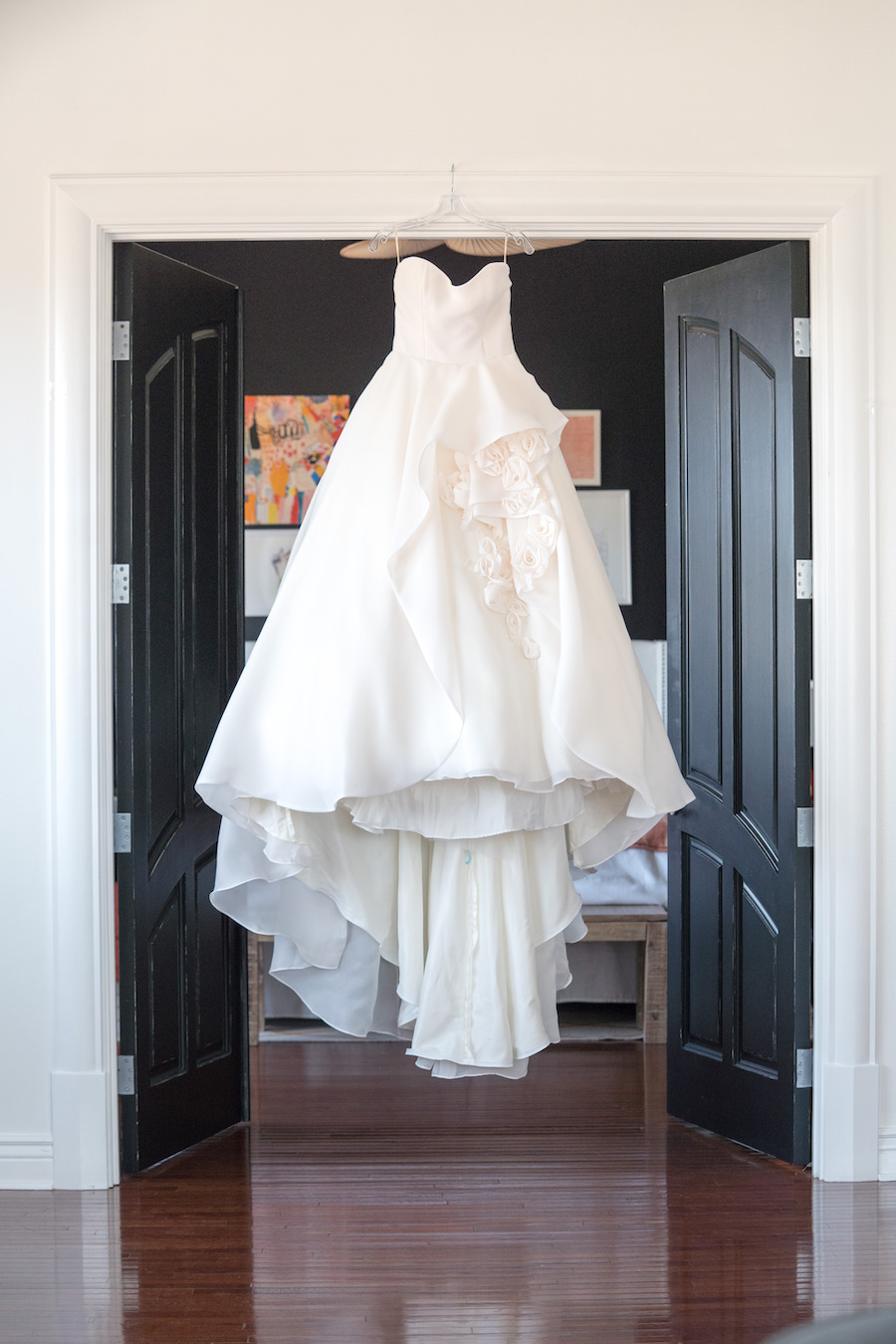 A wedding dress hanging at the penthouse at Loft 310