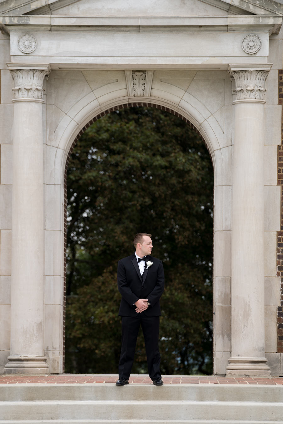 A groom waiting for his first look with his bride