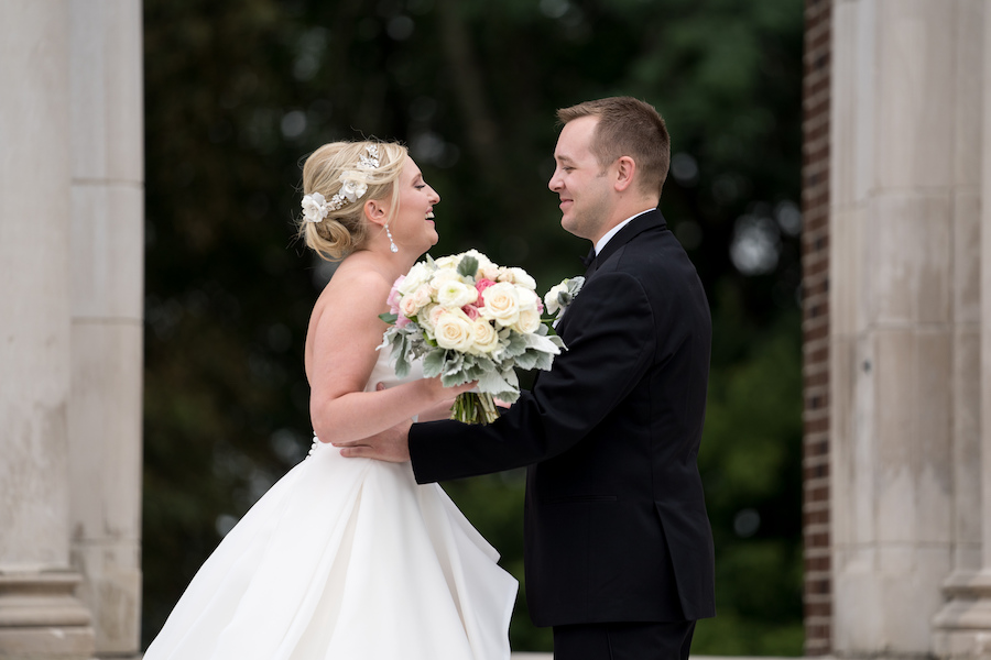 A bride and groom sharing a first look before their Kalamazoo, Michigan wedding