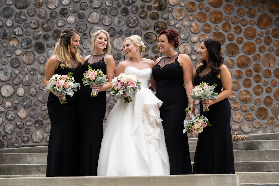 A bride and her bridesmaids smiling before her Kalamazoo, Michigan wedding