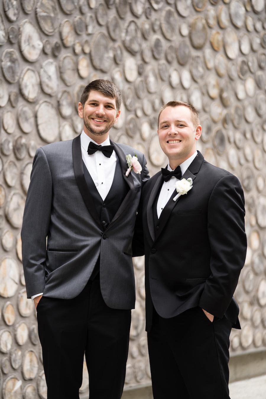 A groom and groomsman smiling before his Kalamazoo, Michigan wedding