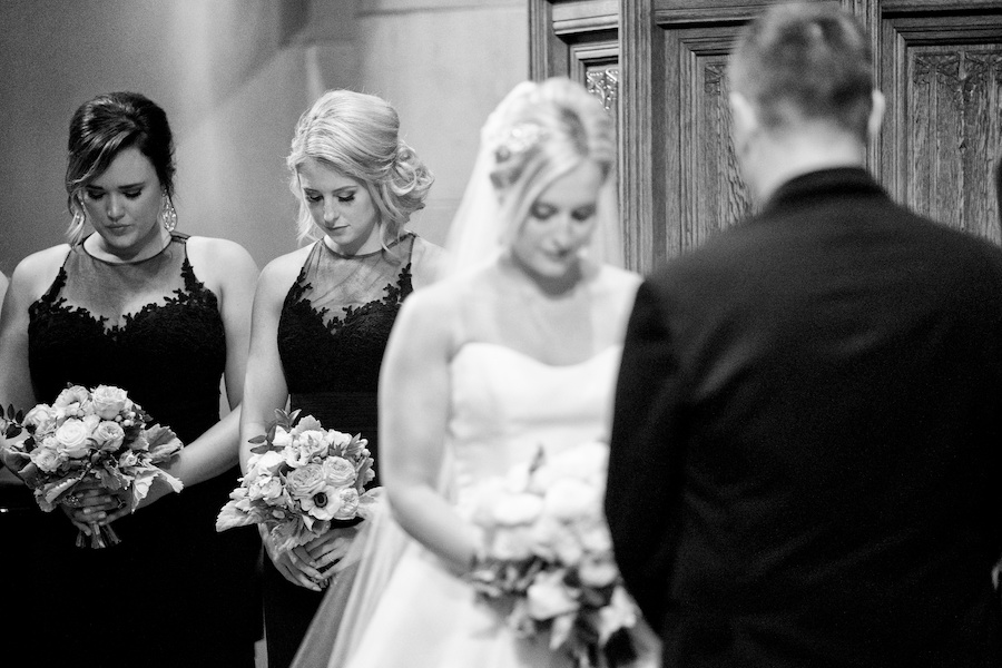 A bride praying during her Kalamazoo, Michigan wedding