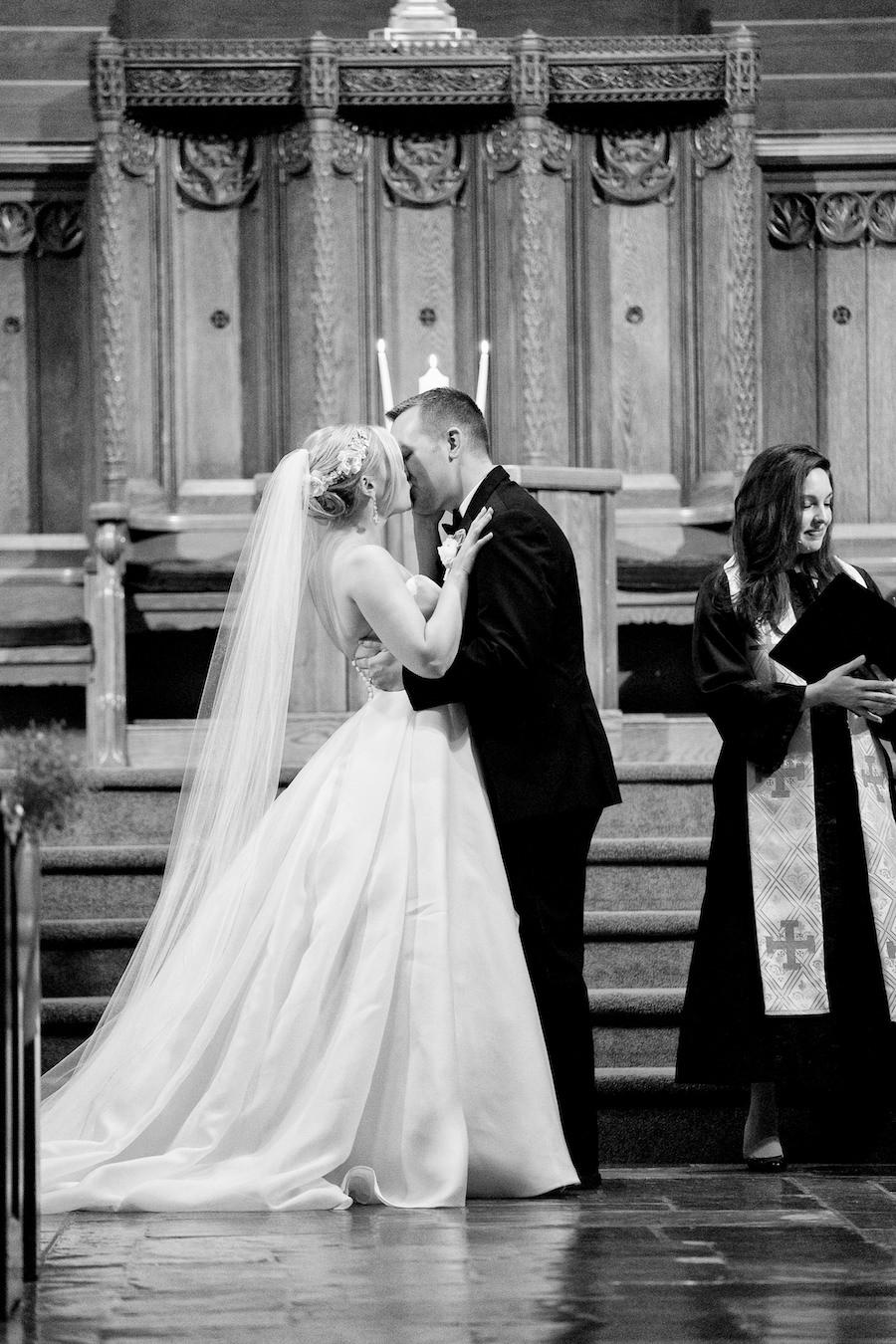 A bride and groom sharing their first kiss during their Kalamazoo, Michigan wedding