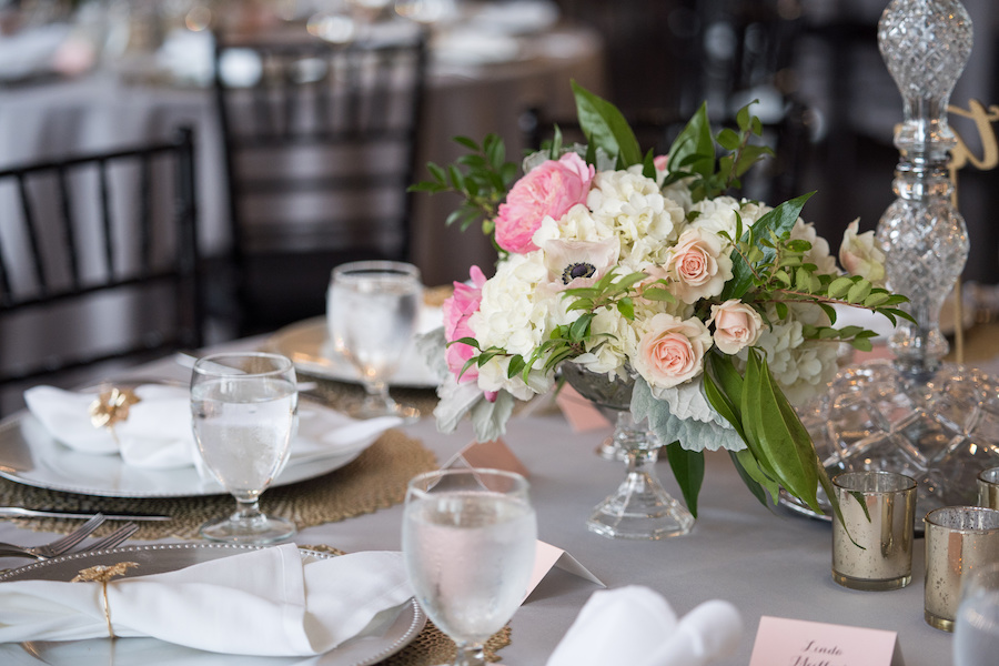 A table set with flowers during a Loft 310 wedding