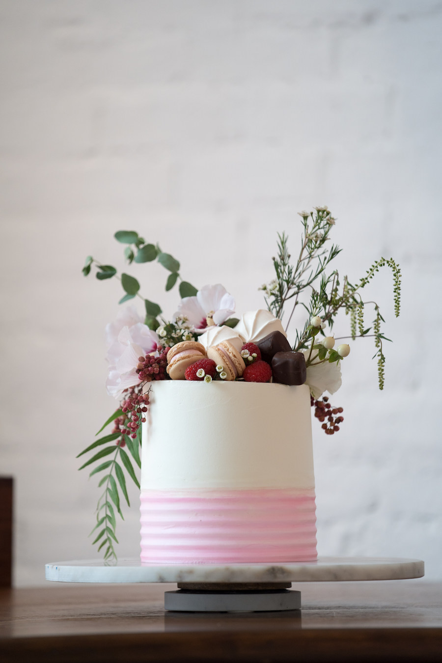 A fun pink and white cake at a Loft 310 wedding