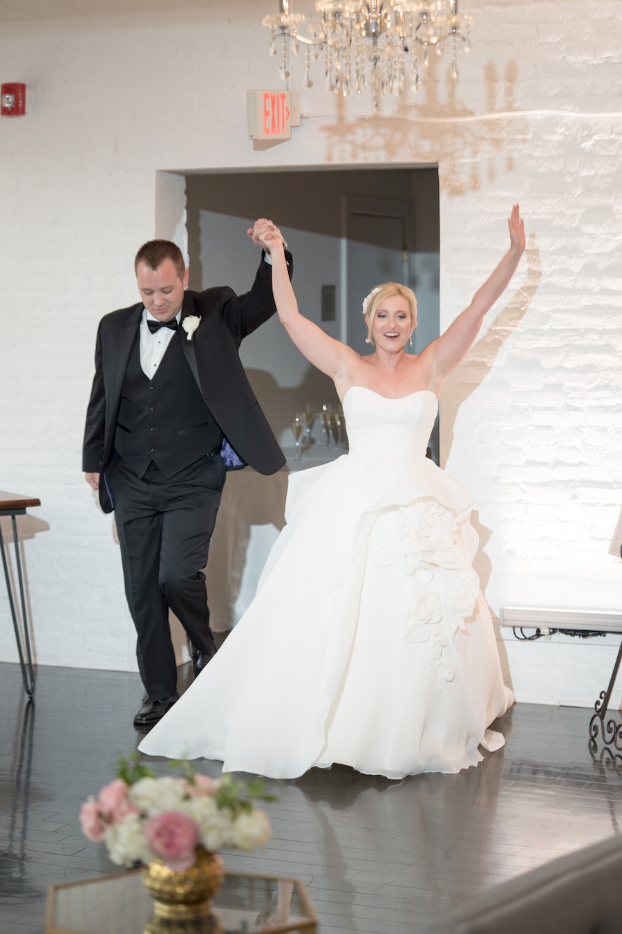 A bride and groom being introduced into their Loft 310 wedding reception