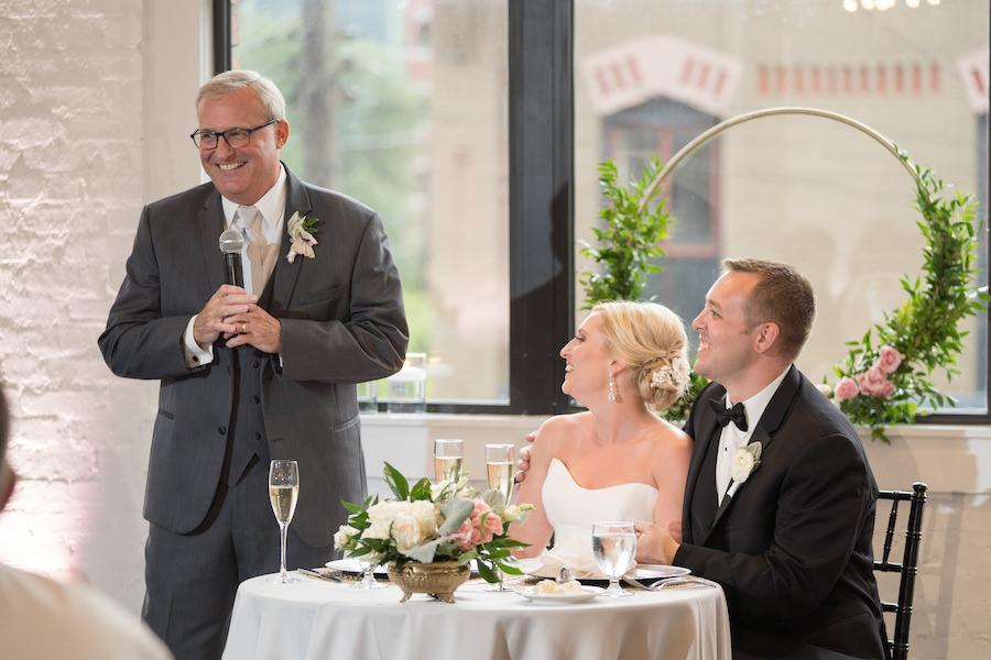 A bride and groom enjoying speeches during their Loft 310 wedding