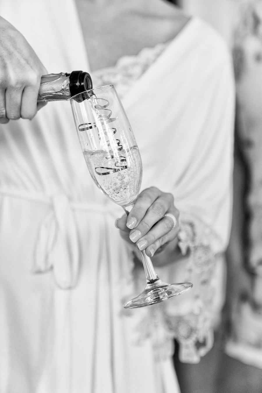 A bride pouring champagne the morning of her wedding
