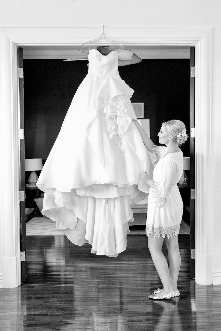 A bride fixing her dress the morning of her wedding