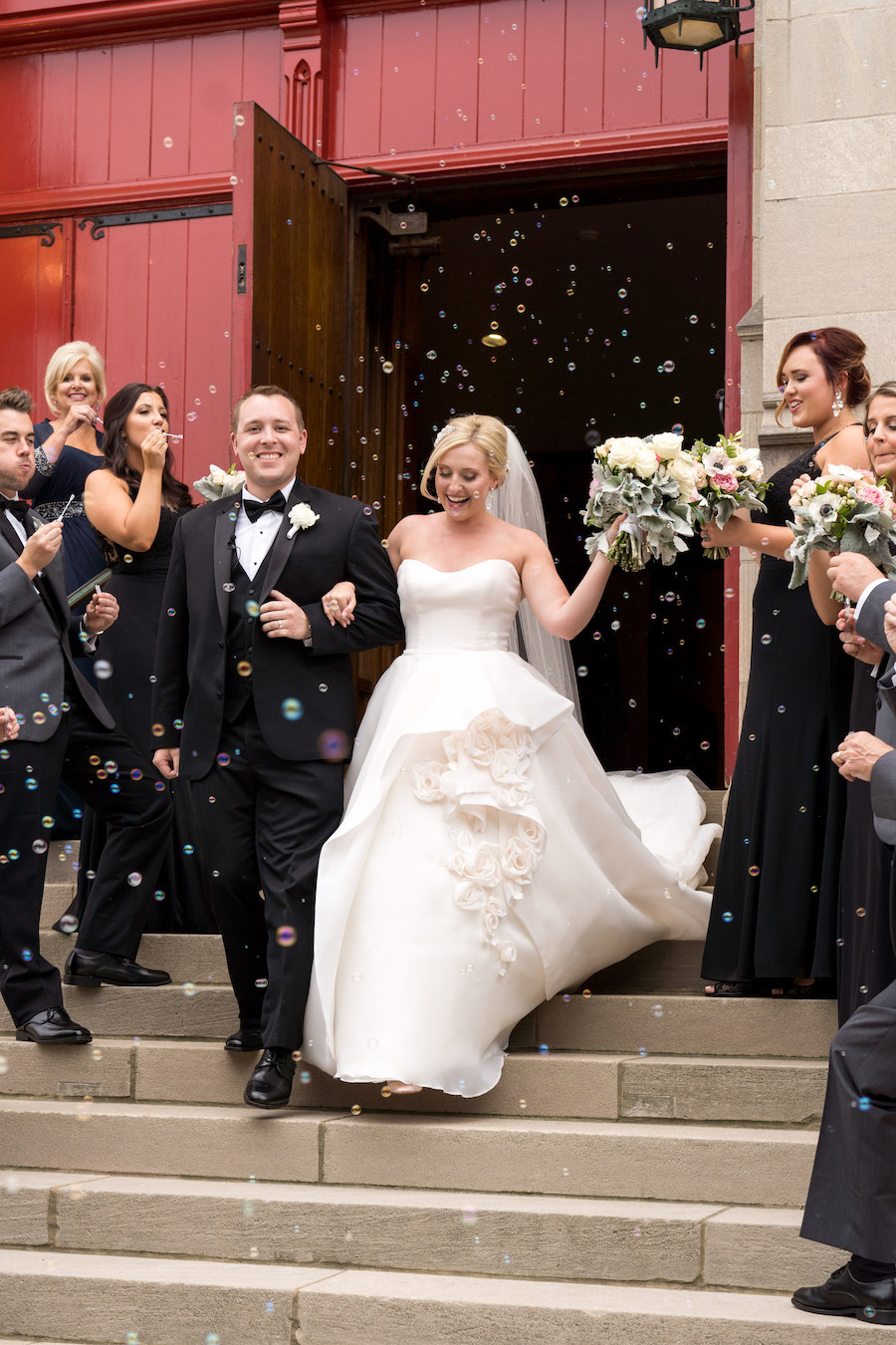 A bride and groom walking out of the church of their Kalamazoo, Michigan wedding