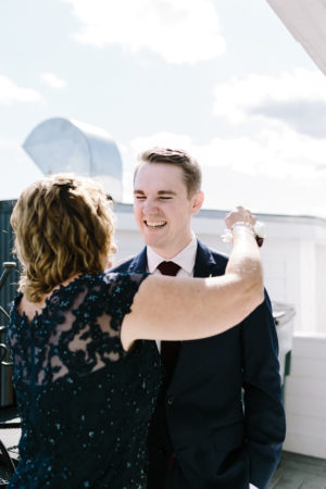 A groom and his mother before his Sky Deck wedding