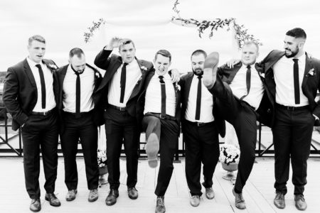 Groom & groomsmen joking around after a Kalamazoo wedding ceremony