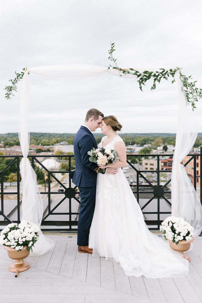 A bride and groom at the alter of their Sky Deck wedding in Kalamazoo, Michigan