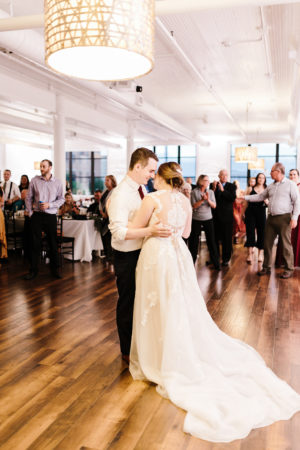 A couple shares their first dance during their Loft 310 wedding in Kalamazoo, Michigan