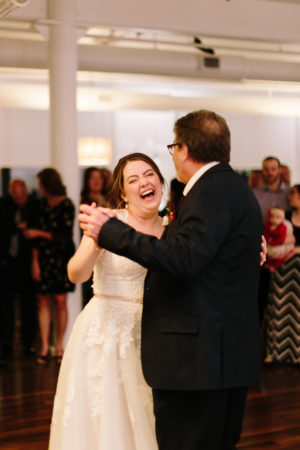 A father and a bride share a dance during a loft 310 wedding