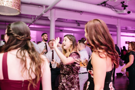 A group of people dancing during a Loft 310 wedding