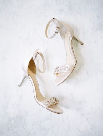 Bridal shoes laying out on a marble backdrop