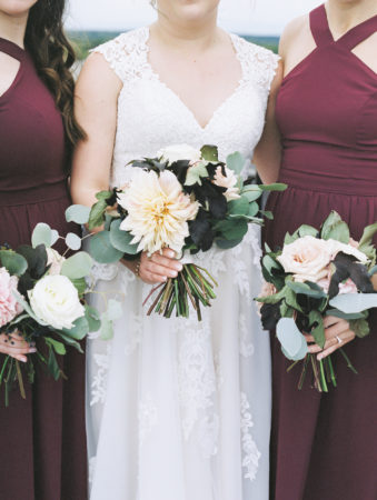Bride and bridesmaids with their dahlia wedding bouquets