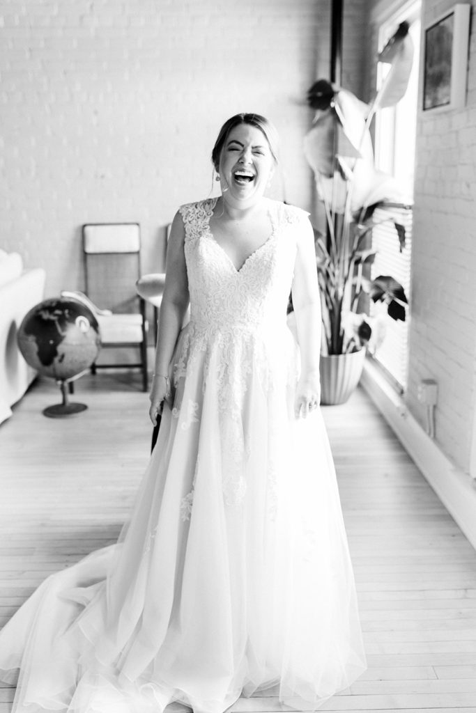 A bride smiling in her wedding dress in Kalamazoo, Michigan