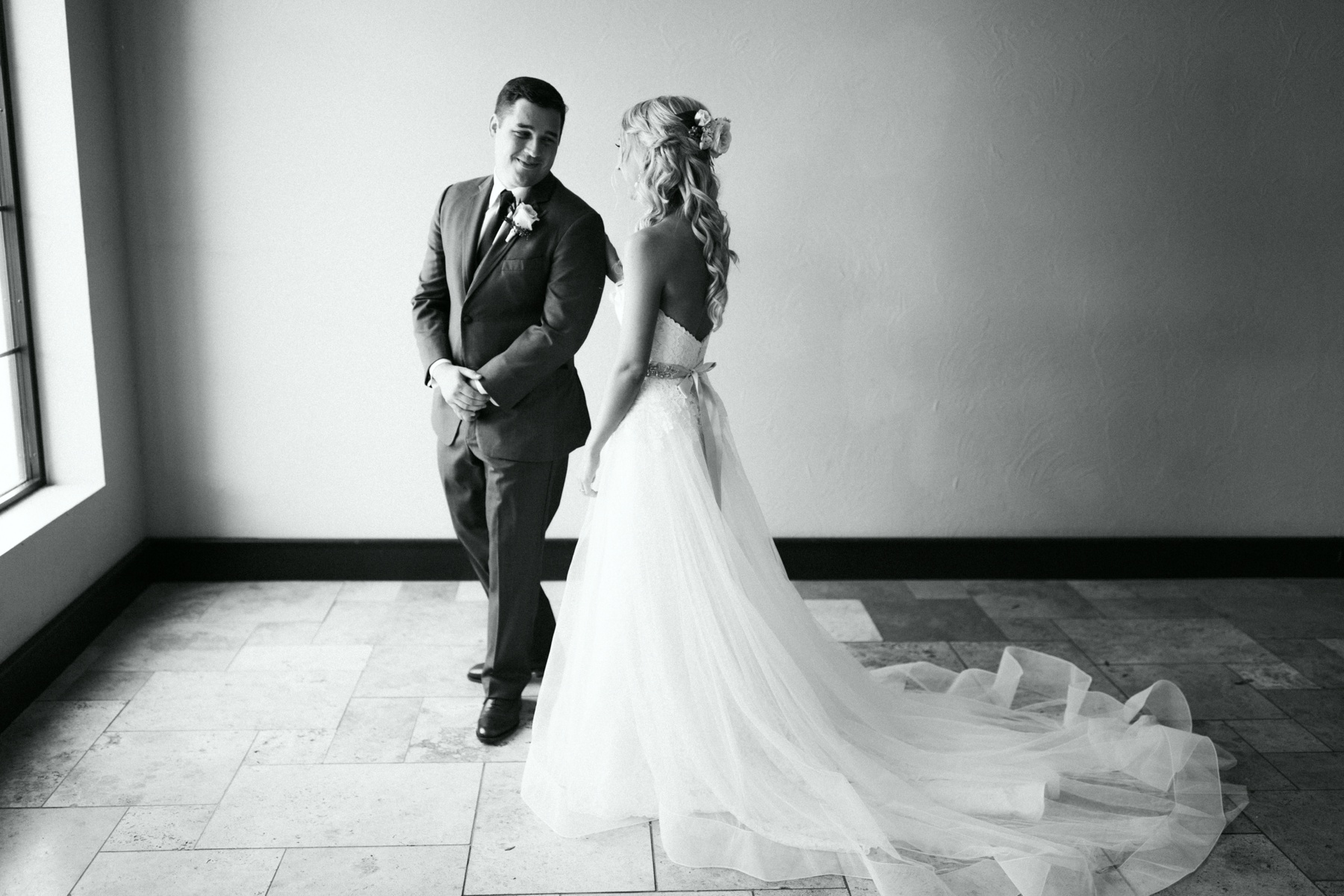 Bride and groom sharing a first look before their spring lake country club wedding