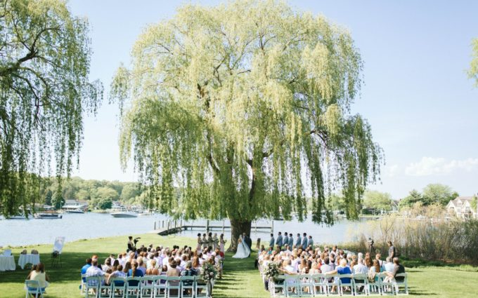 A ceremony happening during a spring lake country club wedding
