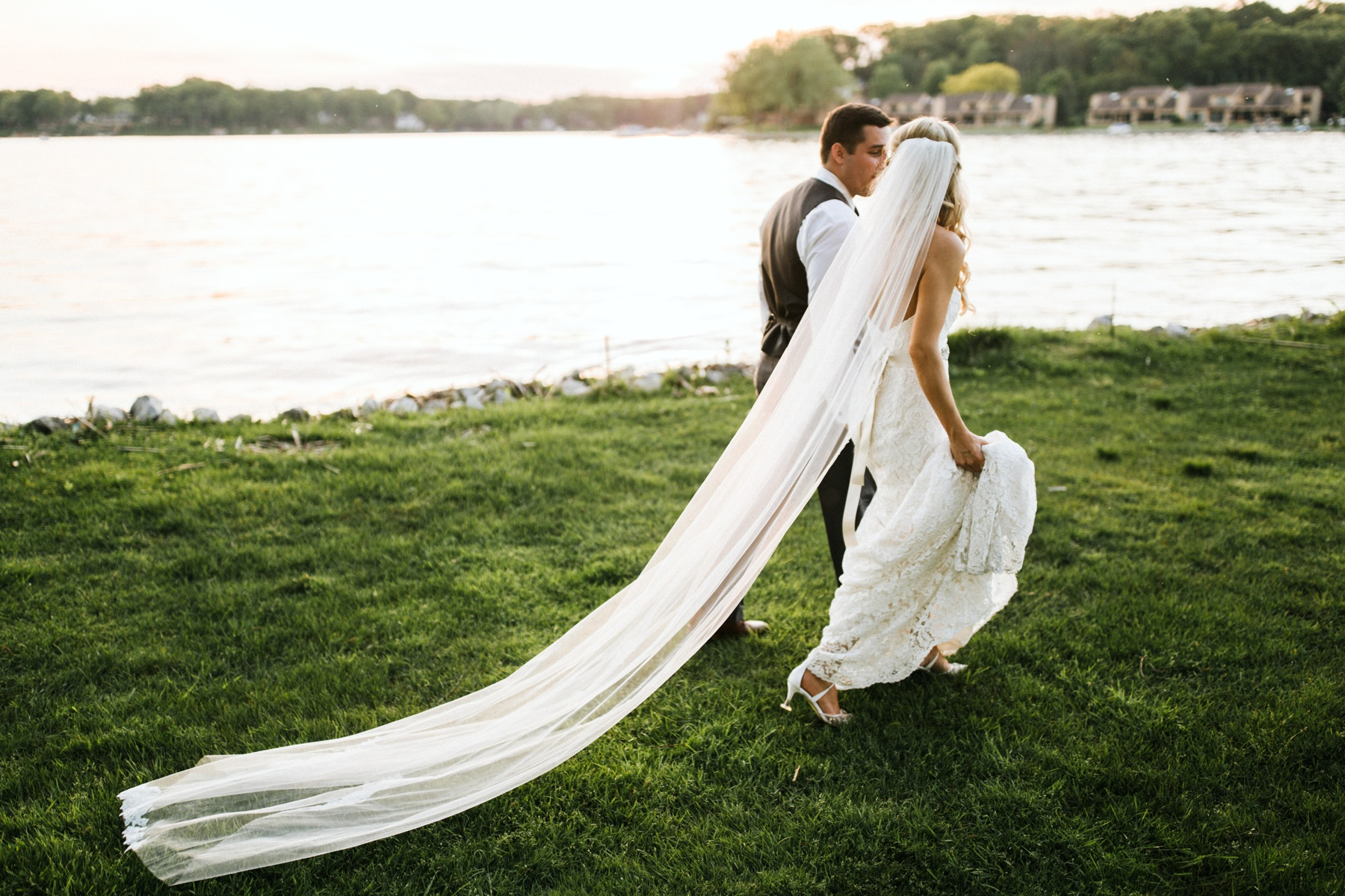 A couple enjoying the lake during their spring lake country club wedding