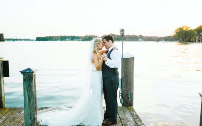 A bride and groom dancing by the lake during their Spring Lake Country Club wedding